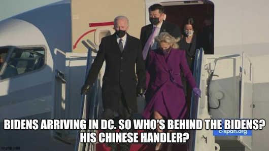 biden arrives in dc chinese handler behind him