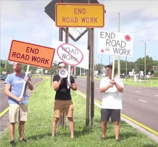 end road work signs protests