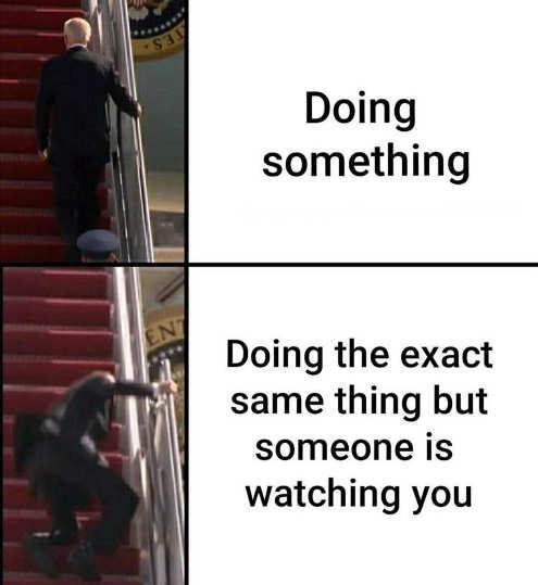 joe biden stairs doing something while someone watching