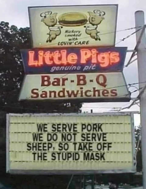 little pigs bar b q we serve pork not sheep so take off mask