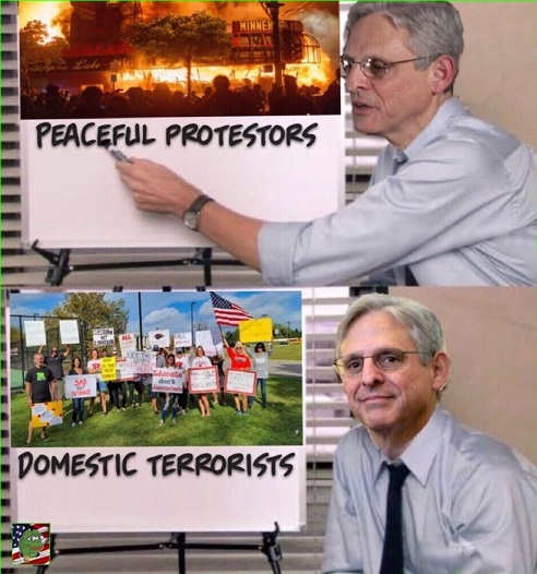 garland ag peaceful protestors blm antifa parents signs domestic terrorists office