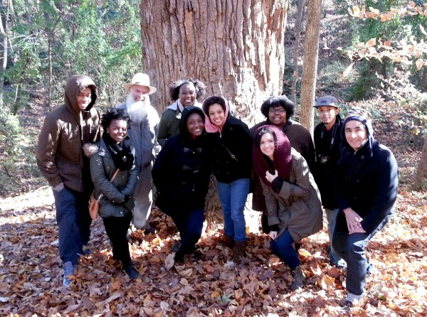 Omar Ali touring the Guilford Forest with students from The University of North Carolina at Greensboro and Quaker scholar Max Carter.  November 2014