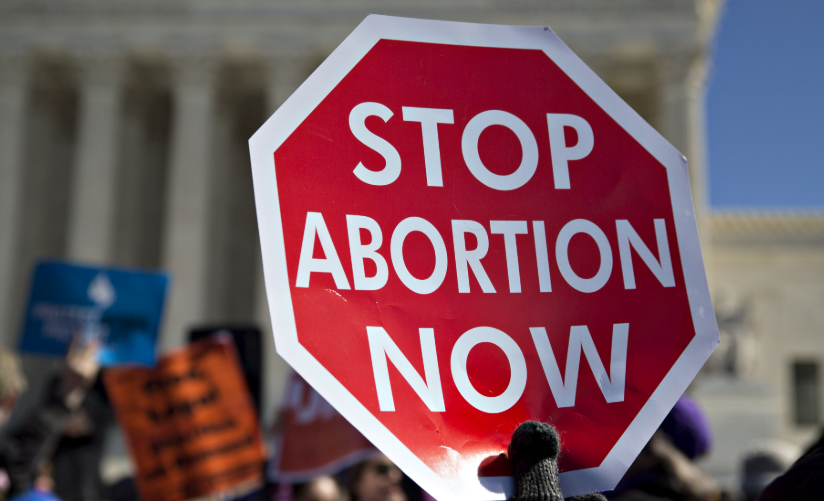 Why do women bear the brunt of abortion-shaming when our economic system is the largest aborter.