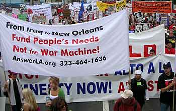 From Iraq to New Orleans, fund people's needs. Antiwar banner