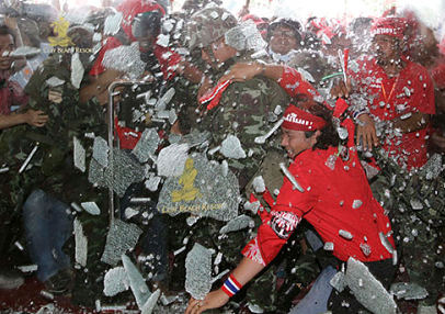 Protesters smash glass door at summit venue. Sukree Sukplang/Reuters