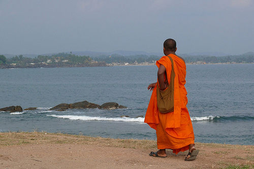IMP1 photo: A Buddhist monk walks the beach in Galle.