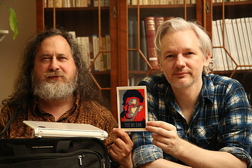 Richard Stallman, Julian Assange, with picture of Edward Snowden. Credit: Wikileaks