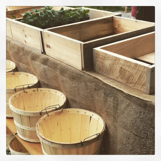 Wooden crates and bushel baskets for farmers market display