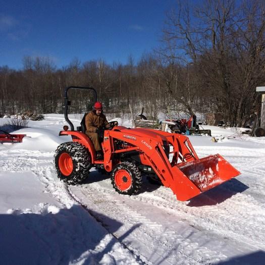 Kubota tractor in the snow bird's nest garden farm