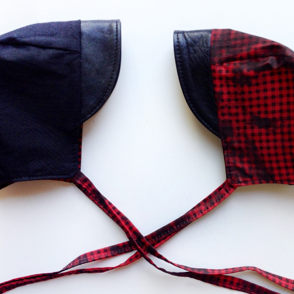 reversible baby bonnet in buffalo plaid and leather, leather baby bonnets