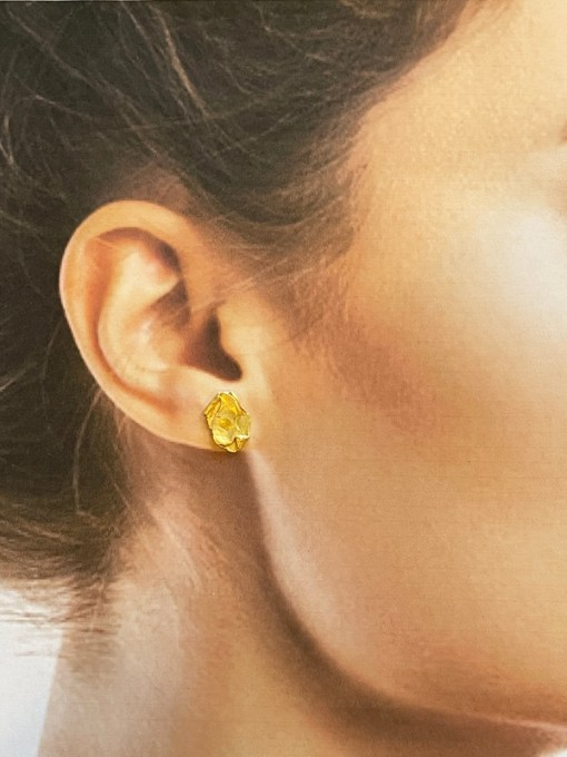 double flake gold earrings modelled