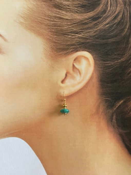 turquoise donut earrings modelled