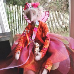 Poppet, Wordsmith and Pen Pal Faery. She has many Faery, Fetch and Magical friends throughout the world who she likes to write letters to.