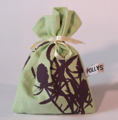 Dark Purple Thistle design on Pea green Fabric