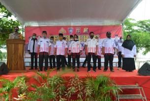 Kapolres Tulang Bawang AKBP Andy Siwantoro, SIK saat mengukuhkan susunan pengurus Pokdar Kamtibmas di Kampung Panca Karsa Purna Jaya