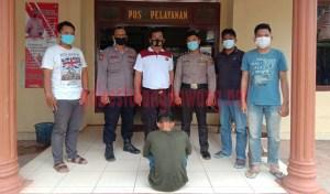 Pelaku pengeroyokan berinisial PK (24), warga Desa Simpang Pematan, Kecamatan Simpang Pematang, Kabupaten Mesuji saat berada di Mapolsek Rawa Jitu Selatan
