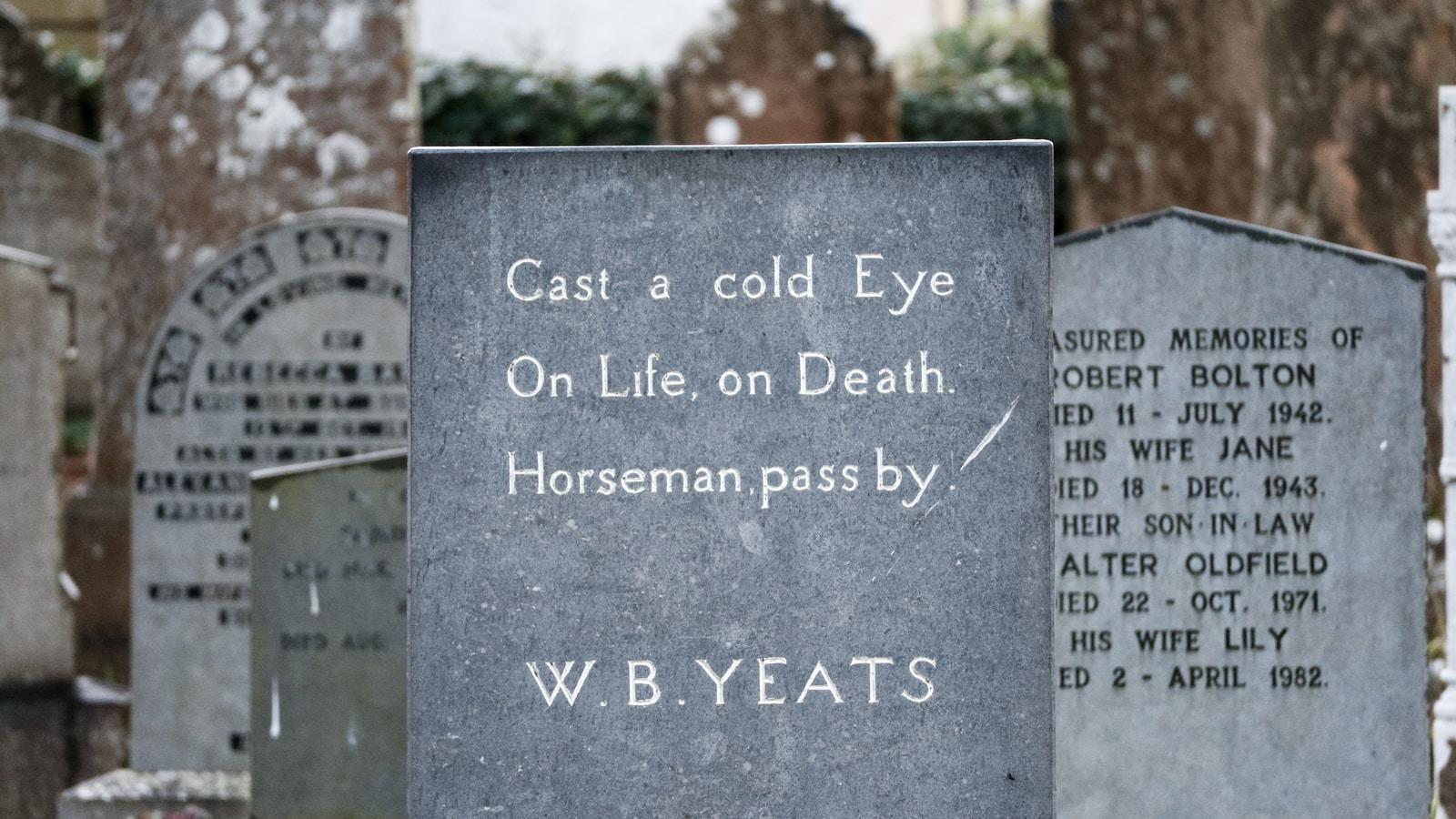 W.B. Yeats tombstone beside tombstones