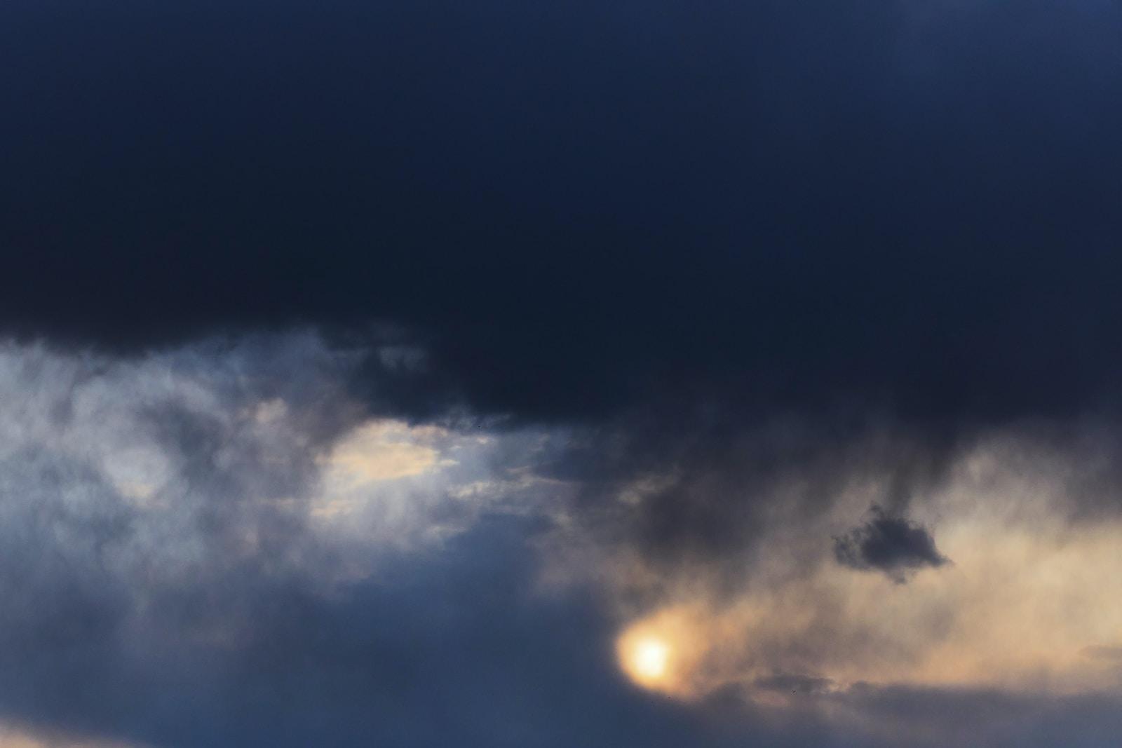 dark sky with white clouds