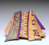 "Karen Woods, Vestments Series Brooch, c. 2012, 3"" h x 2 1/2"" w, polymer, acrylic pigment"