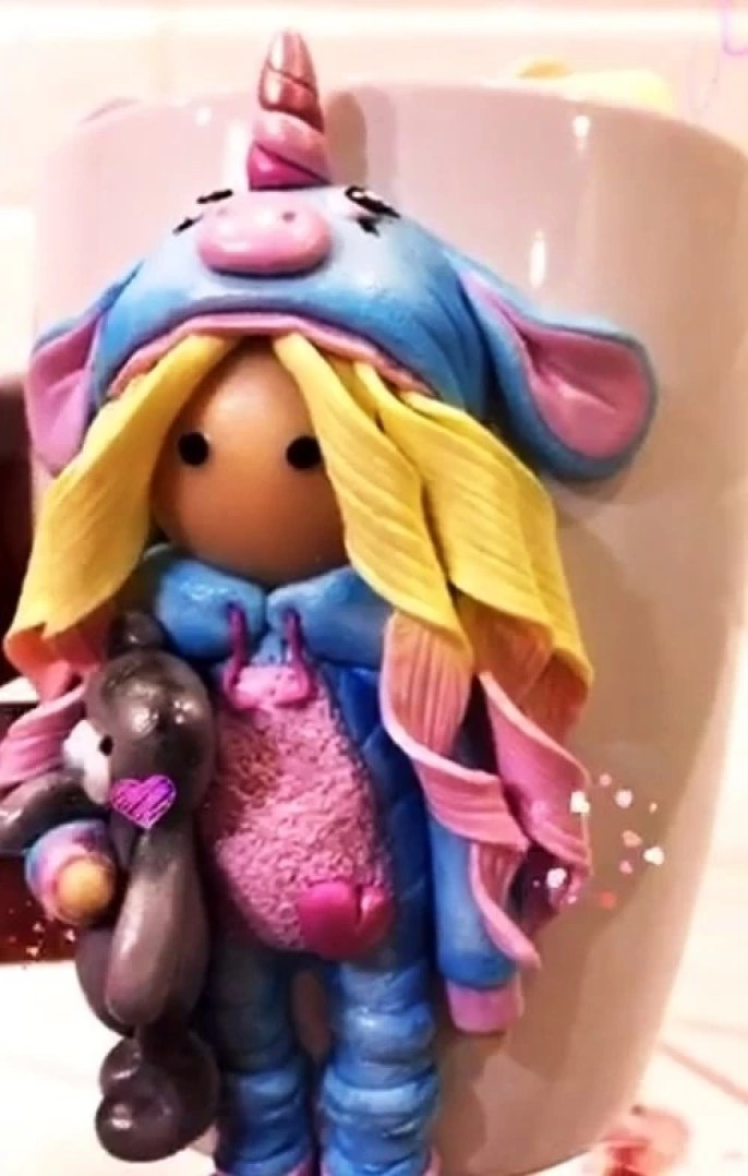 Polymer clay decor: Doll in a unicorn costume
