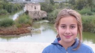 Girl on bridge.