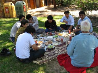 Jack having lunch with a group of Afghanistan men