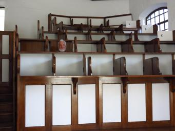 Inside the church confined in standing room, no seats