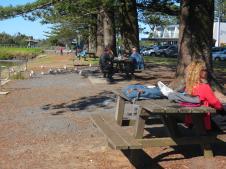 People having picnics along the river bank