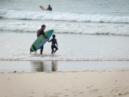 taking daughter for a surf