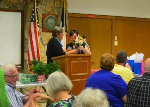 Jeannie presenting Linda with flowers