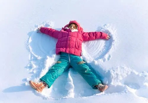 Child making a snow angel