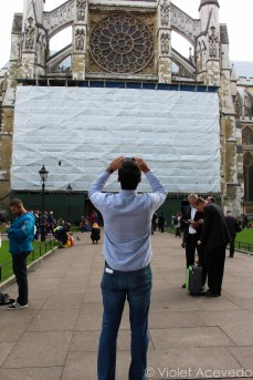 Tourist taking a picture of Westminster Abbey. © Violet Acevedo