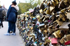 Love locks and selfies along the River Seine. © Violet Acevedo