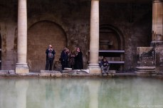 Tourists resting on the lower level of the Roman Baths. © Violet Acevedo