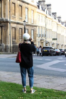 Photographing the streets of Bath at the Circus. © Violet Acevedo