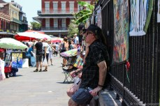 Tourist cooling in the shade in Jackson Square. © Violet Acevedo