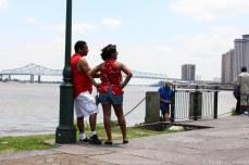Gazing at New Orleans Skyline along the Mississippi River. © Violet Acevedo