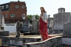 Jesus overlooks the dead souls in St. Patrick Cemetery. © Violet Acevedo