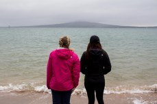 Gazing at Rangitoto Island from the Orakei beaches. © Violet Acevedo