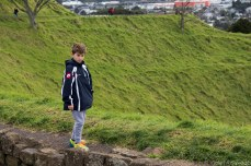 Standing at the edge of Mt. Eden's crater. © Violet Acevedo