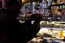 Taking pictures of the cheeses in the South Melbourne Market. © Violet Acevedo
