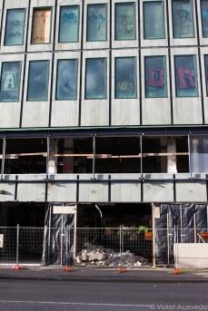 Many buildings still sit empty, awaiting reconstruction. © Violet Acevedo