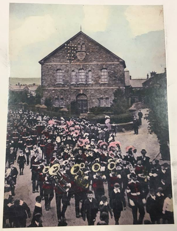 Parade past Hermon Chapel circa 1904