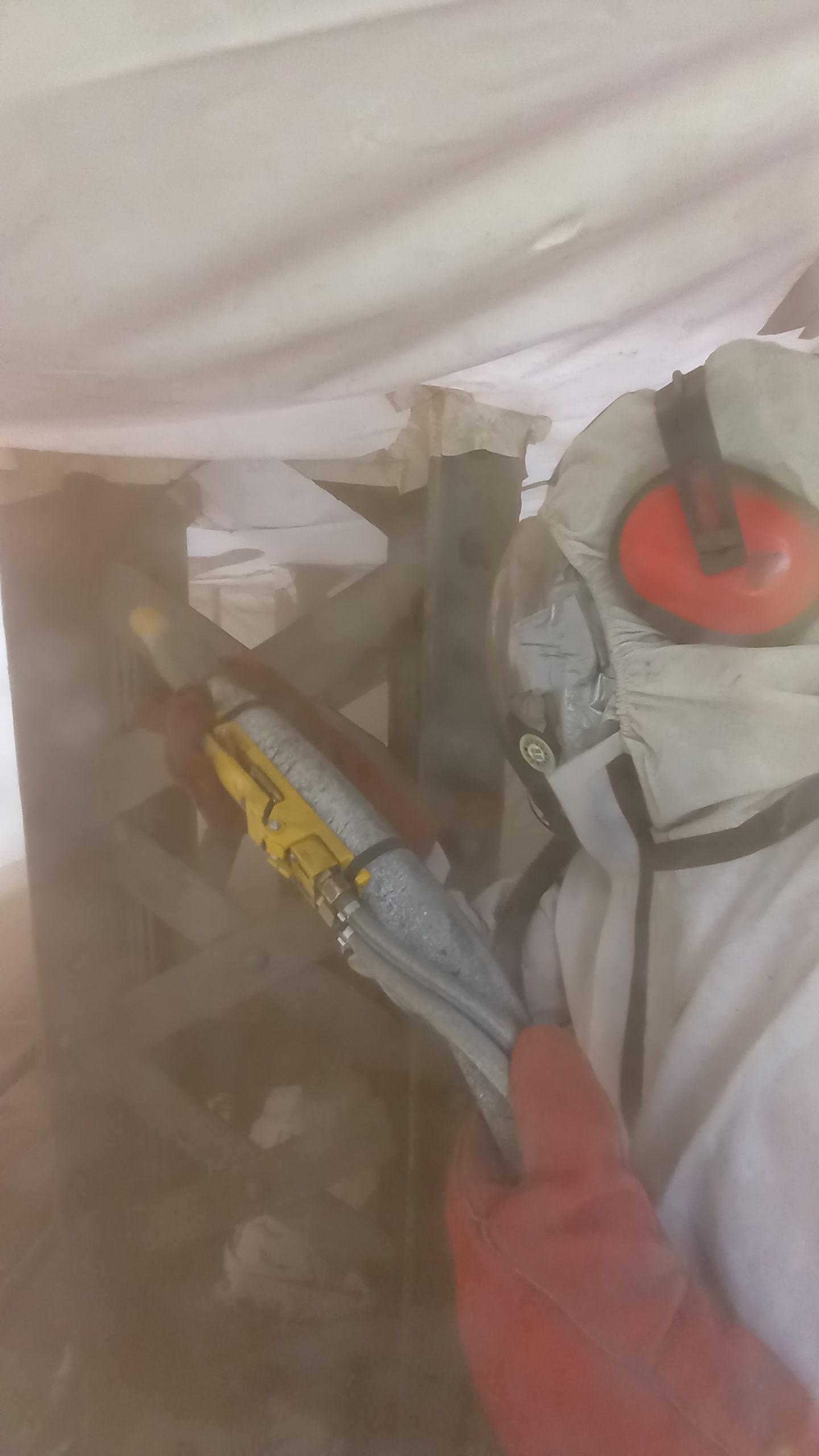 Pont Colbert - Opérateur test de décapage peinture à la grenaillage ® Ports de Normandie