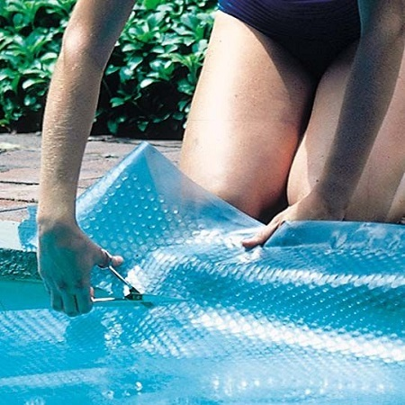 Woman Cutting Pool Cover