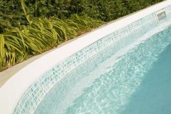 remove hard water stains from pool tiles