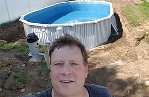 Owner mike with best above ground pool on the planet the Aquasport 52.