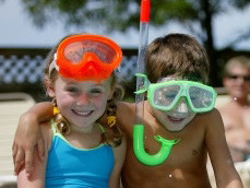 Kids by pool with swimming goggles