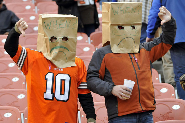 Sad Cleveland Browns fans with paper bags on their heads