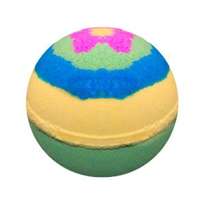 Round bath bomb with three main bands of color. Light green on the bottom, a pastel yellow in the middle and a band of watery blue next. In the blue is a lily pad shaped green circle with a pink and yellow flower in the center.